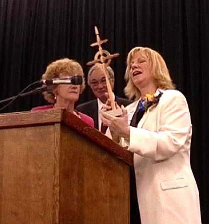 Karen Wright  getting a gift- gardencross